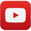 YouTube symbol: red triangle on top of small white rectangle on a red rectangle