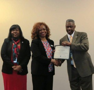 Valerie Ragland receiving certificate from Federal Security Director on 2.14.17