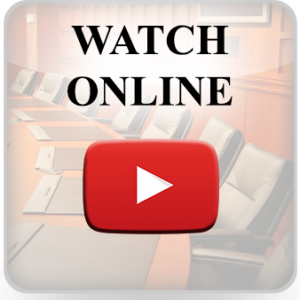 """picture of boardroom with red YouTube """"play"""" button on top and text """"Watch Online"""""""