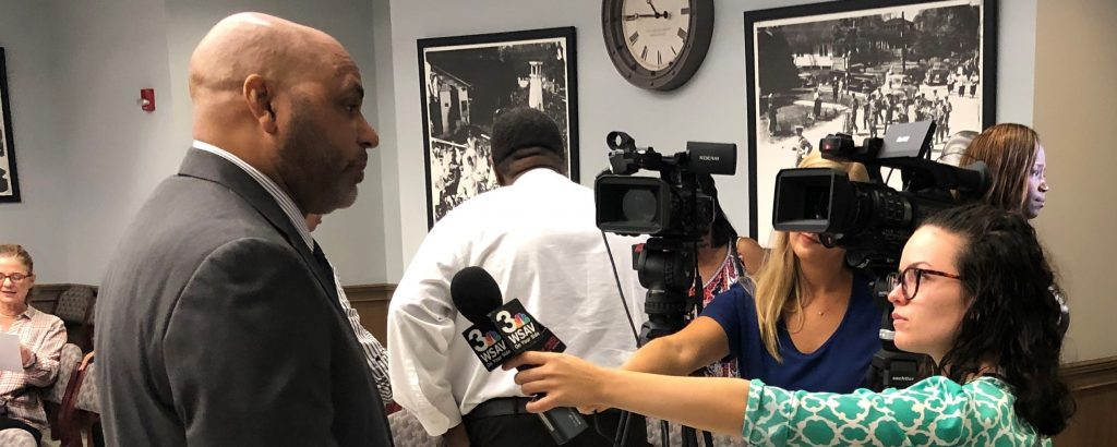 Interim CEO Michael Brown speaks to television reporters on Sept. 30, 2019 about a plan to remove 12 stops from Thunderbolt.